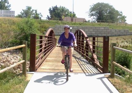 Marna Riding Belle Fourche Bike Path 2014-08-19